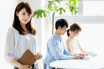 portrait of young asian group in office