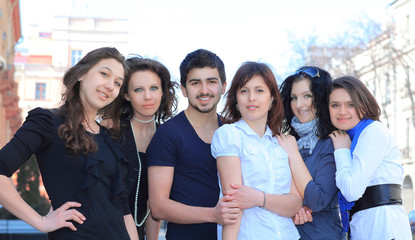 portrait of group of students standing on the street .