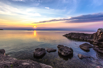 Summer Sunset At The Lake. Beautiful sunset over the horizon of Lake Superior at Copper Harbor in the Upper Peninsula of Michigan.