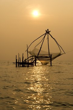 View of Chinese fishing net in Vembanad lake during sunrise