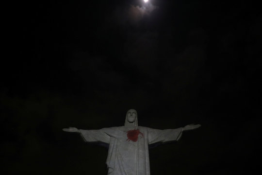 "The statue of Christ the Redeemer is lit up with a red heart to launch the campaign named ""Movement to Survive,"" to warn elderly people who suffer diabetes about cardiovascular diseases, in Rio de Janeiro"