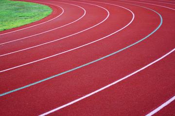 red outdoor running track in sport field