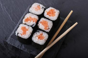 Maki rolls with over grey background. Japanese Sushi. close up.