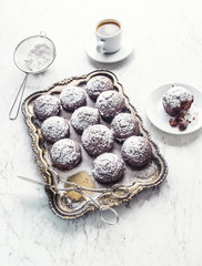Homemade bakery and sweet muffins with powdered sugar
