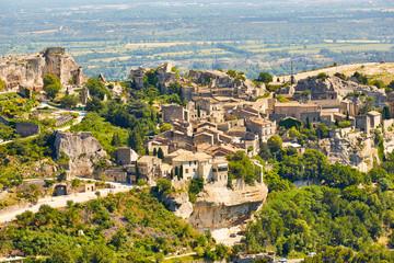 Provencal village Les Baux de Provence and view of Sarragan  stones