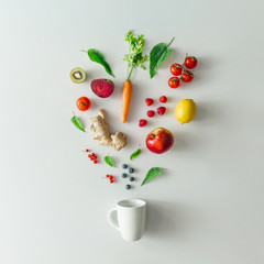 Creative food layout with fruits, vegetables and leaves on bright marble table background with tea...