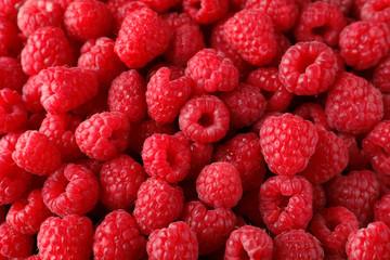 Fresh ripe raspberries as background