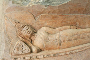 Reclining buddha image carving on wooden