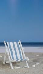 Blue white striped deck chair on the beach
