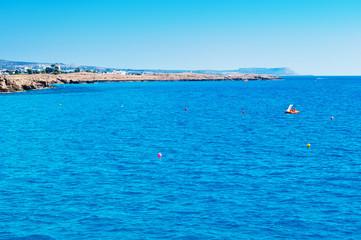 One orange paddleboat in deep blue water
