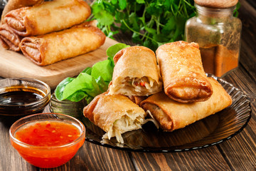 Spring rolls with chicken and vegetables served with sweet chili sauce or soy sauce