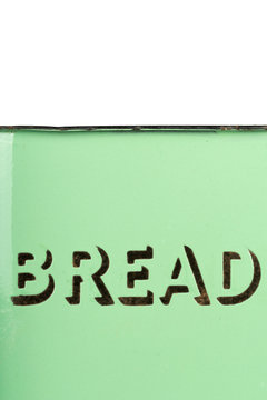 Wording on the side of a vintage 1930s green enamel bread bin. Potential use as background for recipe / ingredients / bakery price list.