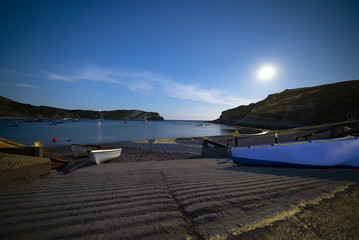 Twilight nightfall at Lulworth Cove on the UK's Jurassic coast