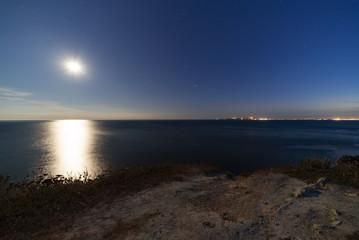 Twilight nightfall at Lulworth Cove on the UK's Jurassic coast