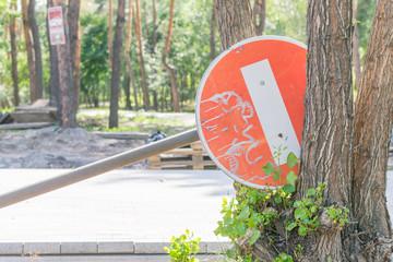 The fallen road sign-do not enter.