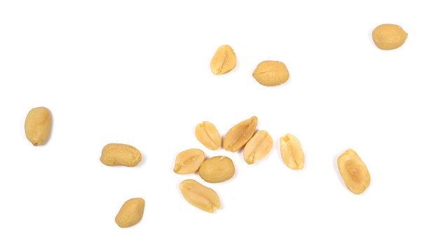 Salty peanuts, pile isolated on white background, top view