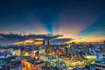 Top view Cityscape Wat Traimitr-withayaram or Wat Tri-mit in Yaowarat area in Bangkok city, Bangkok, Thailand.