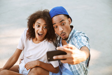 Portrait of a funny young african couple taking a selfie