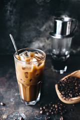 Traditional Vietnamese milk coffee on rustic background
