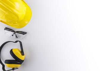 Earmuffs, Safety Goggles, and Hard Hat with Copy Space