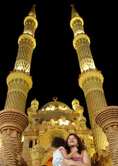 "A woman takes a picture in front of Al Sahaba Mosque at a popular tourist area named ""Old Market"" in the Red Sea resort of Sharm el-Sheikh"