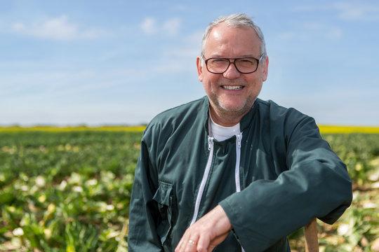 Portrait of a senior attractive farmer working in a field - Nature concept