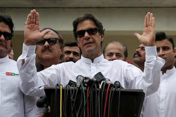 Imran Khan speaks to members of media after casting his vote at a polling station during the general election in Islamabad
