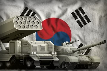 Republic of Korea (South Korea) heavy military armored vehicles concept on the national flag background. 3d Illustration