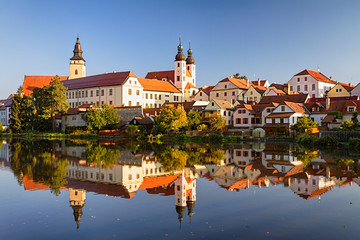 View of Telc across pond with reflections, southern Moravia, Czech Republic.