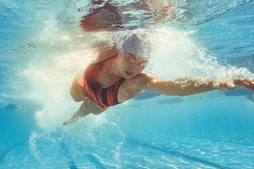 Fit female athlete during swim training