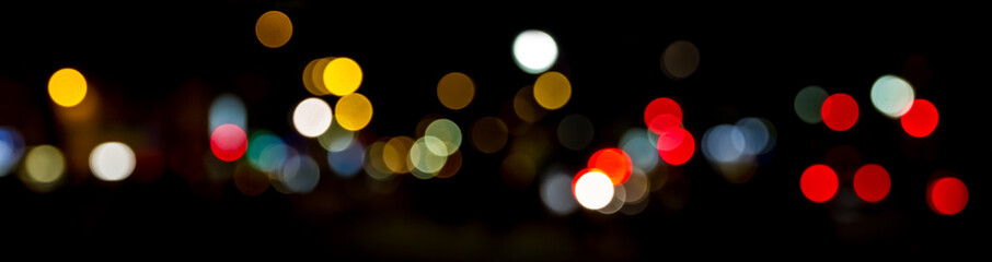 Bokeh traffic light at night in the street of a big city