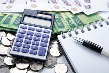 business still-life from a calculator and a bundle of russian banknotes