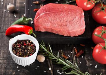 Deurstickers Vlees Fresh raw beef steak meat on wooden board