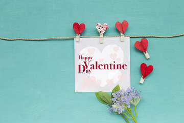 Happy Valentine's day card concept decorate with red heart clip and flower on blue background