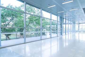 Blurred abstract background interior view looking out toward to empty office lobby and entrance doors and glass curtain wall with frame