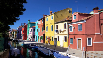 Wonderful view of multicolored residential buildings and Venetian canal, Burano