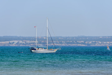 seascape with sailing yacht on the horizon