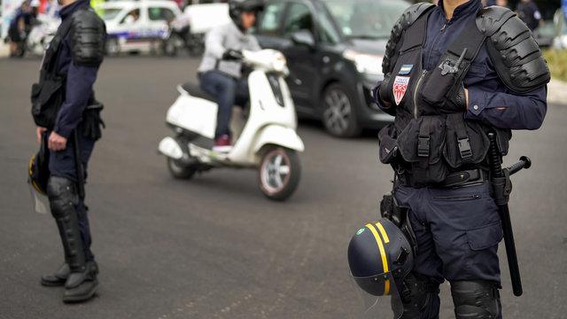 French policemen cordon off street, blocking traffic, threat of terrorist attack