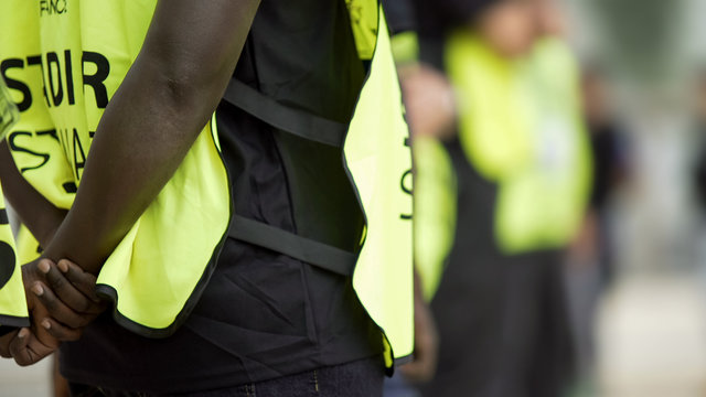 Stewards supervising and controlling security, safety measures at sports arena