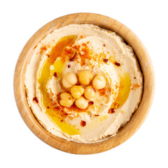Classic chickpea hummus with olive oil and paprika in wooden bowl isolated on white.