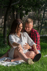 Young adults happy awaiting the birth of first child