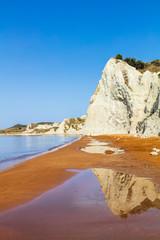 Beach with orange sand and white rocks