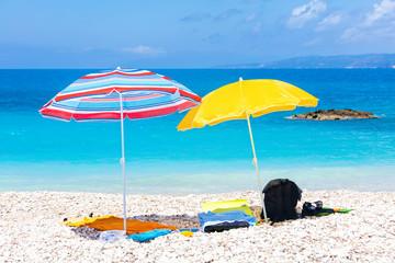 Colorful beach umbrellas by the blue sea