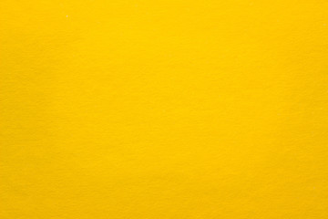 bright texture yellow sheet of colored cardboard