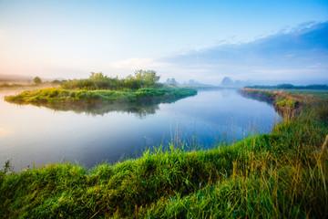 River curve under blue sky landscape. Sunny morning in the rural area