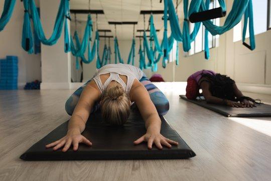 Two women performing yoga exercise