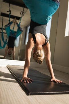 Woman exercising on swing sling hammock