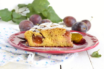Slice of cake from corn meal with plums