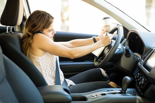 Woman multitasking while driving