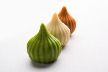 Sweet Tiranga coloured modak shape mithai or dumpling for Independence or republic day greeting card